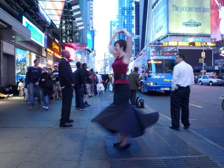 Tove Hermanson twirling in Times Square.
