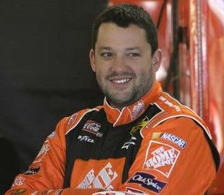 NASCAR driver Tony Stewart sporting his (also orange) sponsor's logo