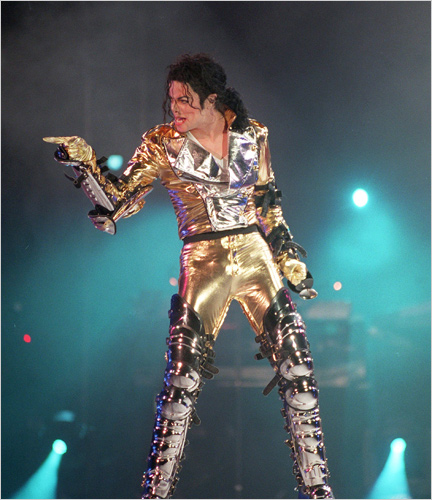 Michael Jackson in gold lame with leather buckles and catcher kneepads in HIStory tour 1992 Prague