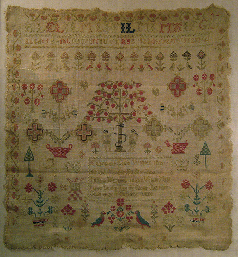 "Early 19th century sewing sampler stitched by Elizabeth Lyle when a young girl.  The text in the center reads,""Elizabeth Lyle worked this in the eleventh year of my age. In the morning think what you have to do. And at night ask yourself what you have done."""
